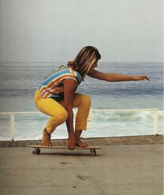 Photo of Robin Calhoun, an award-winning surfer, skating in Laguna in 1964 by Leroy Grannis scanned from Leroy Grannis: Surf Photography of the 1960s and 1970s.