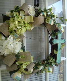 I love, love, love this wreath. In fact I found the cross at Hobby Lobby (50%) off and I want to make it. Just need flowers.