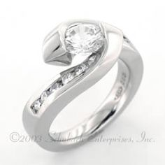 Tension Set Engagement Ring With Channel Set Side Diamonds $4275 and up.