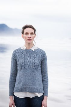 This pullover in Shelter honors every feature of the traditional gansey. Stout chain cables boldly mark the textured yoke both fore and aft. The gentlest of A-lines makes for an easy fit, and details like the split ribbed hem and decorative side seams make Caspian both eye catching and knitterly. The front and back are …
