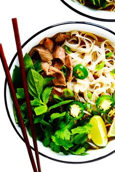 This Vietnamese pho soup recipe is made with the most amazing broth and your choice of beef, chicken, pork or shrimp. Load up your bowls with rice noodles, pile them high with all of your favorite fresh garnishes and enjoy! | gimmesomeoven.com #pho #soup #vietnamese #asian #noodle #healthy #glutenfree #mealprep #dinner