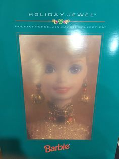 Holiday Jewel™ Barbie® 1995 Holiday Porcelain Barbie Collection® Product Code: 14311 She brings the warmth and joy of the holidays right into