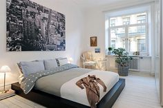 Love the bed low to the ground like this...and the colors are a good blend of masculine and feminine.