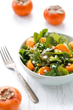 A delightful winter salad featuring persimmons, pistachios, goat cheese, and blood orange vinaigrette from loveandoliveoil.com.