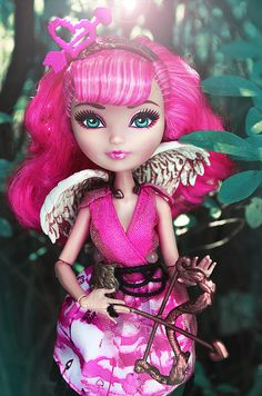 C.A. Cupid Wave 1.5 Signature Ever After High Doll, 2013 (I bought her at Big Lots.) - This doll has been re-released. Cupid is the daughter of Eros, the god of love. She is an Ever After High Rebel. Cupid was a cross-over character who transferred to Ever After High as a spin-off of Monster High.