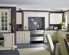 Hmmm… I have white cabinets, black granite counters and stainless appliances. I just might have to go eggplant in the kitchen.