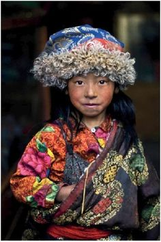 """Young nomad girl keeps warm in Kham,Tibet. By This image is featured in my book """"Face to Face: Portraits of the Human Spirit. Steve Mccurry, Eric Lafforgue, Beautiful Children, Beautiful People, Precious Children, Costume Tribal, Population Du Monde, Alison Wright, Cultural Dance"""