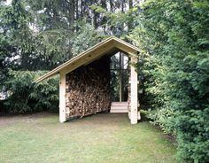 Wooden Hut / Kawahara Krause Architects, firewood storage as chapel.  Beautiful little garden structure!