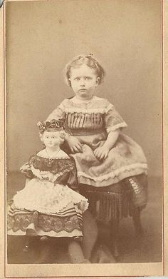 Girl and large doll