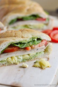 Turkey, Artichoke and Basil Subs - French bread is stuffed with artichoke hearts, turkey and vegetables and then slathered with an easy basil sauce in this easy sandwich that's perfect for a picnic or for dinner.