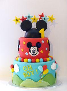 Moelleux chocolat, crème vanille et framboises Tout est réalisé en pâte à sucre Mickey peint à main levée [[[D'après un modèle de Gâteau Sur Mesure]]] Très bon anniversaire au petit Gabriel, qui fête sa première année !!!
