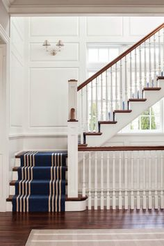 & Big Steps {Part One White, navy and wood staircase with a striped runner and paneling.White, navy and wood staircase with a striped runner and paneling. Navy Stair Runner, Staircase Runner, Wood Staircase, Staircase Design, Stair Runners, White Staircase, Staircase Ideas, Cottage Staircase, Floating Staircase