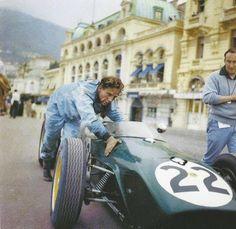 Monaco Grand Prix, May 20, 1960. Innes Ireland pushes his Lotus past the Hotel de Paris.