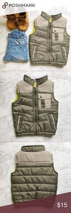 Osh Kosh Olive Green Toddler Vest GREAT USED CONDITION. Put it over a flannel and pair with some jeans, throw a hoodie under and rock with some sneakers, or pair with some boots! It's a super versatile piece for your minis closets and keeps them nice and warm without so much bulk. Shorting on collar was bought like this and was not a result of mistreated washing/drying. Osh Kosh Jackets & Coats Vests