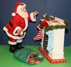 Possible Dreams His Littlest Fan ~ Clothtique Santa Claus with cat #713195 #possibledreams #santaclaus #santafigurine #clothtique #hislittlestfan #santawithcat #christmascat