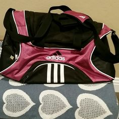 Adidas duffel bag Black and pink Adidas athletic bag.  Used but still in great condition. Adidas Bags