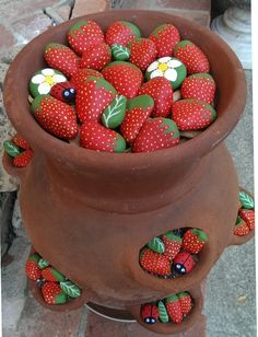 Inspiration for my next project. I have this pot (saw it in the barn yesterday) and I have painted three ladybugs and one frog so far.   Painted Rocks, Ladybugs, strawberries, leaves, flowers