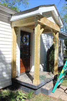One of my biggest goals with our exterior renovation was to update this poor little entrance that we Front Porch Addition, Front Porch Design, Home Exterior Makeover, Exterior Remodel, House With Porch, House Front, Porche Frontal, Front Porch Remodel, Front Porch Makeover