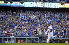 Fans cheer as Los Angeles Dodgers' Carl Crawford rounds the bases after he hit a three-run home run in the second inning of Game 3 of the National League division baseball series against the Atlanta Braves, Sunday, Oct. 6, 2013, in Los Angeles. (AP Photo/Mark J. Terrill)