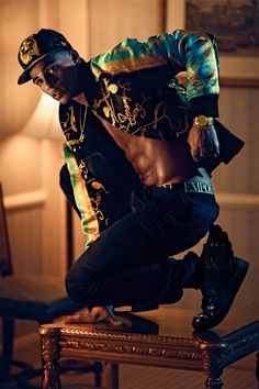 French 25 year old breakdancing phenom Brahim Zaibat, shot by Sebastian Faena and outfitted by Carlyne Cerf de Dudzeele with pieces from Jeremy Scott, Versace, Diesel, Emporio Armani and more, for the issue #29 of VMan magazine.