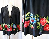 Femme fatale vintage black silk kimono fire red lining and detailed print at the hem and inside Asian goddess - size Medium to Large. $250.00, via Etsy.