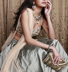 steel grey lehenga , plain lehenga skirt , bustier lehenga , gold and silver lehenga , gold clutch , friend of the bride