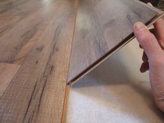 How to Lay Laminate Flooring in One Day: Tilt Planks at 45 Degree Angle to Place Them