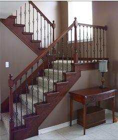 Elegant dark stain & wrought iron stair case