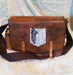 Attack on Titan messenger bag by LuithiensCreation on Etsy $92.02 There's one for every branch besides The Survey Corps.