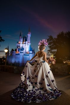 This butterfly wedding dress looks incredible during a very early morning portrait session at the Magic Kingdom. Photo: Stephanie, Disney Fine Art Photography