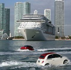 Image: A fleet of Fiat watercraft welcomes the cruise ship MSC Divina in Miami on Nov. 19 (© Walter Michot/Miami Herald/MCT/Landov)