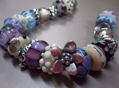 Here is a bracelet with the new Messenger bead!  Join the most inspirational forum anywhere! http://trollbeadsgalleryforum.ning.com
