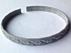 3D-printed geometrical bracelet; made of nylon plastic: Flexible, Lightweight & Strong. Available on http://www.etsy.com/shop/MatthiasBD in different colours.