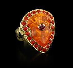 Paula Crevoshay Mandarine Garnet ring ~ One of Crevoshay's specialty cuts featuring a Mandarine garnet weighing 9.43cts framed by 0.57cts of Fire Opals and a 0.10ct Spinel set in the center of the Mandarine. 18k gold.
