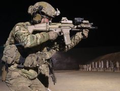"U.S. Army Special Forces, or ""Green Beret"", member on the firing line in Afghanistan w/SCAR 16"