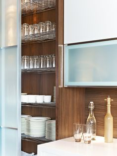 All mill-work designed, provided and installed by Yorkville Design Centre Featuring tall sliding glass doors with wire shelves for storage. Modern Kitchen Cabinets, Smart Kitchen, Kitchen Design, Kitchen Decor, Kitchen Ideas, Sliding Glass Door, Glass Doors, Hotel Kitchen, Kitchen Cabinet Organization