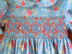 Hand smocked dress Size 2/2T Blue with coral & yellow flower
