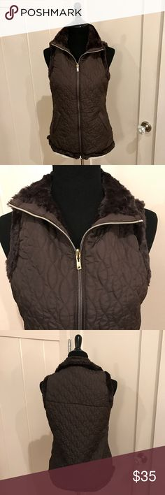 """Casual Identity Reversible Vest Small New Gorgeous Chocolate quilted & faux fur reversible vest with gold tone zipper & pockets. Approx measures 17"""" chest 23"""" long. Faux fur shows well around arm openings & hem. Fabric has a slight sheen & gives an upscale look. Beautiful & new with tags. Casual Identity Jackets & Coats Vests"""