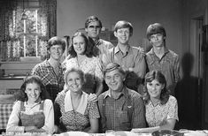 Hit show: Earl  Hamner Jr is shown in glasses with the cast of The Waltons in October 1978