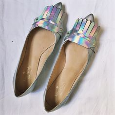 REDUCED HP Kate Spade Gallery Loafers Worn a few times. There's are some scratches from wear (see pics) but overall still in good condition.   Shimmering with silver leather, this Kate Spade flat is ideal for anyone looking to add some sparkle to their wardrobe. With a tassel on the toe and covered heel, this stylish and sparkly heel is ideal for the princess inside us all. Made in Brazil.  No trades please  kate spade Shoes Flats & Loafers