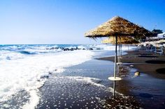 Cool off on the beautiful black sand beaches of Kamari, on the East side of #Santorini, Greece. #StylishEscapes