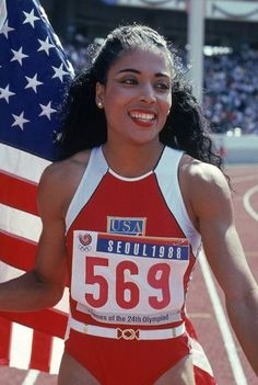 """Florence Griffith Joyner  With her cascading curls, crimson lips, and out-to-there nails, Olympic superstar Florence Griffith Joyner (aka """"Flo Jo"""") was one of the 80's most influential beauty trendsetters."""