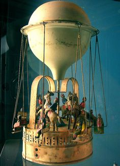 """Victorian Era Toy Hot Air Balloon.    This and that horse r,acing game in the movie """"Dave"""""""