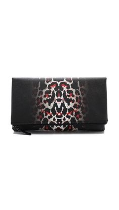 McQ by Alexander McQueen clutch (for more animal prints -- http://chicityfashion.com/animal-prints/)