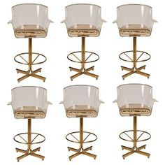 1970s Charles Hollis Jones Lucite and Brass Swivel Bar Stools, Set of Six | From a unique collection of antique and modern chairs at https://www.1stdibs.com/furniture/seating/chairs/