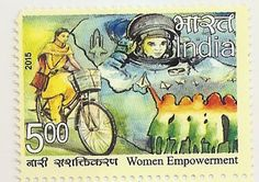 This stamp portrays a girl riding on a bicycle (non-polluting vehicle). She could be going to school or to her job or could be a social worker or just visiting et al. To the right are shown five girls in the colours of the Indian flag – Saffron, White and Green – flying paper aeroplanes and looking forward to a limitless future where women astronauts of Indian origin have travelled to outer space. A space shuttle is shown in the background.