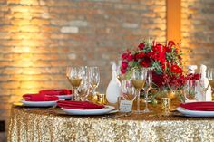 gold and red tablescape red flowers centerpiece by Splendid Stems