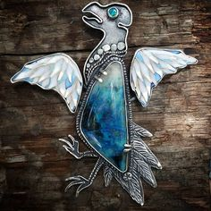 Instagram media by kristinholeman - #2 in the Vulture series. This is a white vulture with cloisonne wings, an Arizona Blue Lightning stone from @davidhunter01, opal eye, set in oxidized sterling silver. Pendant with chain.  Sorry for all the pics today but I have 2 shows coming up in the next few weeks,  so they're coming fast and furious!  Only 1 more vulture to go. #artrider