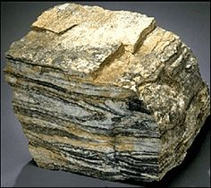 Acasta Gneiss, NW Canada.  The oldest known rock on Planet Earth (4.031 Billion years old +/- 0.003 Billion years).      I've touched this exact piece at the Smithsonian Museum of Natural History in DC!