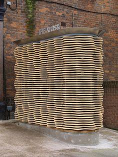 Undulating timber slats surround this London flower kiosk by Buchanan Partnership